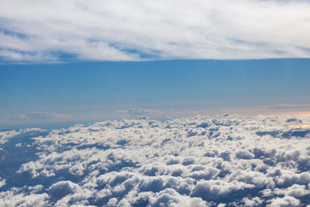 Amazing cloudy sky view from airplane window photo