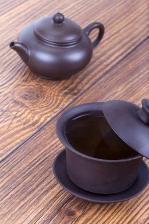 chinese tea ceremony: Chinese tea ceremony with ceramic set on wooden table