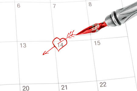 memorize: Point out Valentines day in the calendar isolated on white Stock Photo