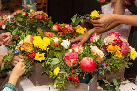 floristic: Floristic masterclass. Bouquet arrangement process Stock Photo