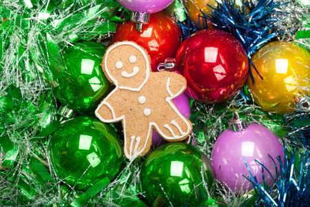 Gingerbread Christmas Man with bunch of Colorful baubles and tinsel Stock Photo