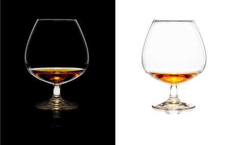 Glasses of whiskey over black and white on isolated background Stock Photo