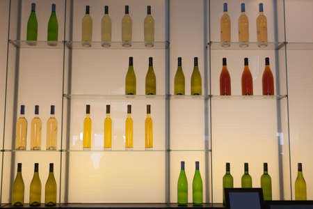 Shelves with colorful bottles of alcohol drinks.