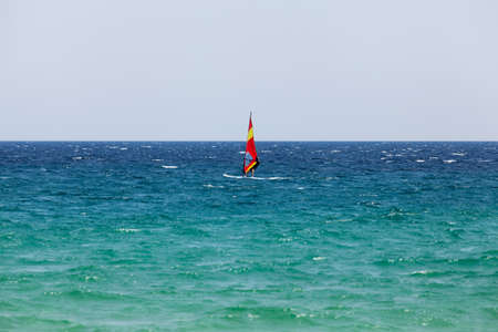 Windsurfing. First recreational water sports lessons during summer vacation