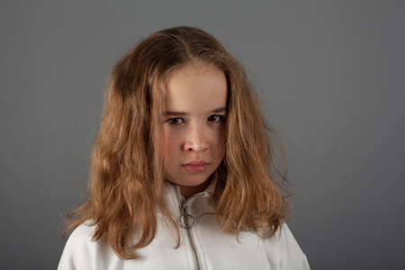 Cute teenage blond girl with sad face