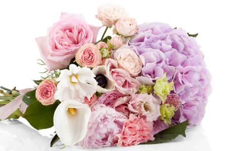 Beautiful professional dishevelled bouquet of flowers isolated on white background