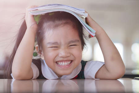 kid book: education and school concept -A asianjapan, chinese, korea pretty girl hold a book and reading Stock Photo
