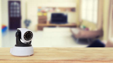 ip camera: Security camera on Wood table. IP Camera.