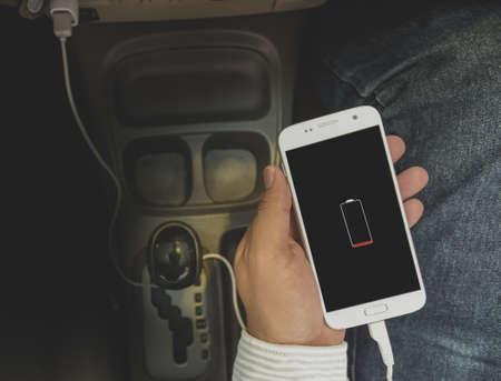 Charger plug phone on car Standard-Bild