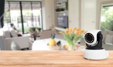 Security camera on Wood table. IP Camera.