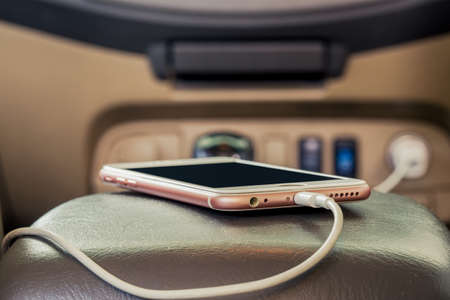 Charger plug phone on car Imagens