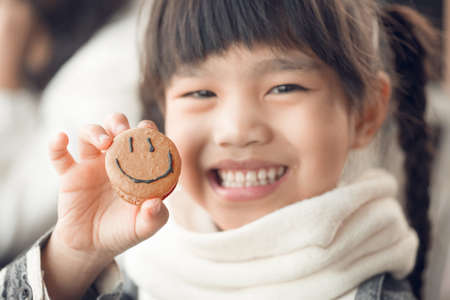 Portrait of beautiful asia Children feel happy eating Bread smiley face