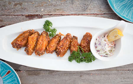 Sticky Chinese Chicken Wings with soy sauce and sesame Stock Photo