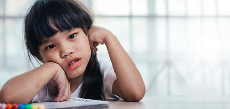schoolgirl , childhood and education concept ,asia girl exasperated with his homework Stock Photo