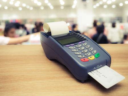 Credit card terminal or EDC machine on wooden background Foto de archivo