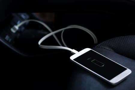 Charger plug mobile phone on car Фото со стока - 79412075