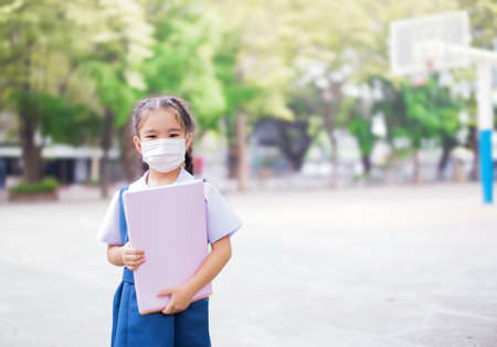 curator: Healthcare - girl wearing a protective mask Stock Photo