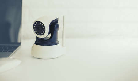Security camera on white table. IP Camera.