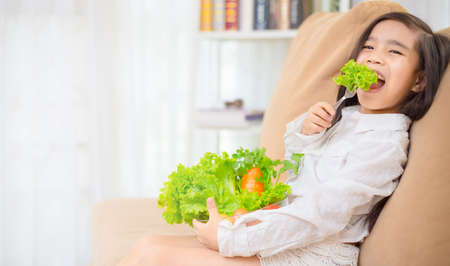 Asian cute girl eats fresh salad ,healthy eating concept Stock Photo