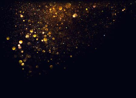 glitter vintage lights background. gold and black. de focused