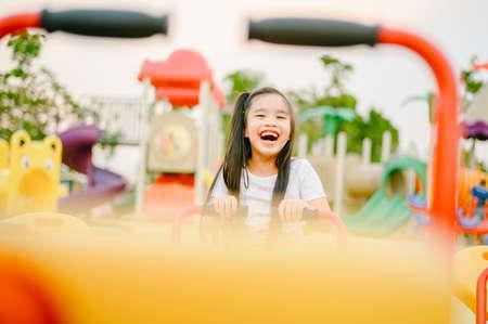 Child Playing having fun on playground Imagens - 122401044