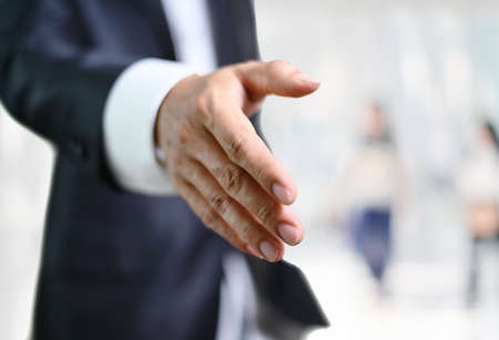 Business man open hand ready to seal a deal, partner shaking hands Imagens