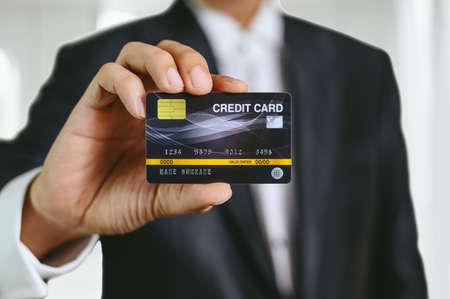 businessman holding credit card mockup . Plastic bank-card design mock up
