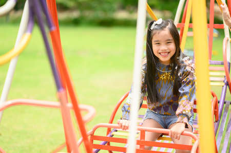 Child Playing having fun on playground 版權商用圖片 - 125214481