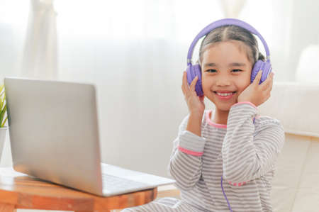 lifestyle Young asian girl relax listening to music in home