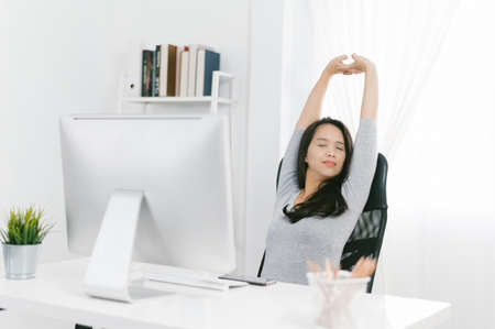Business woman relaxing and sitting on an home office chair. Asian lady 版權商用圖片