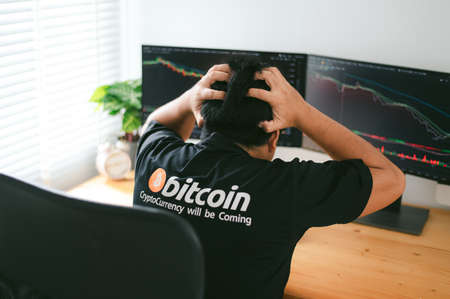 Despair man on down stock bitcoin graph market background.