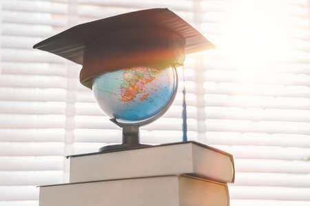 Graduation cap on top of the globe, education concept design