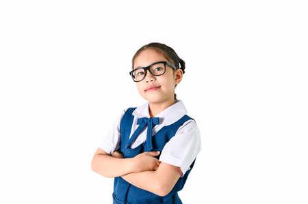Portrait of smiling, little girl in school uniform Isolated on white background 版權商用圖片