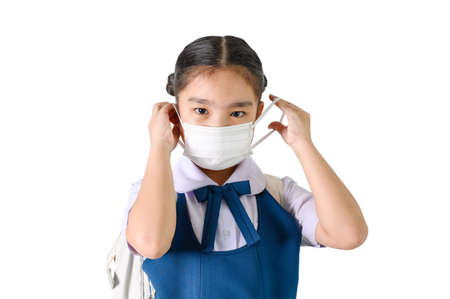 School Girl wearing mouth mask against air smog pollution on white background