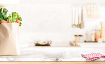 Wood table top on blurred kitchen background 版權商用圖片