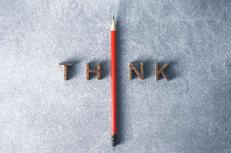 One  Pencil with word think leadership and uniqueness concept. Stand out from the crowd. Think outside the box. Dare to be different