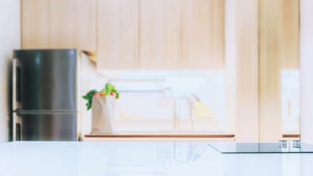 white glossy counter top and blur kitchen room background