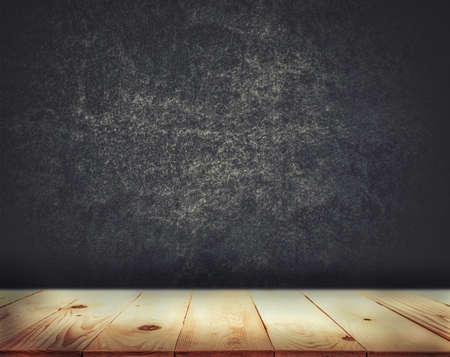 Empty top of wood table with grunge concrete wall texture background