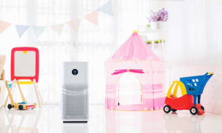 air purifier of colorful playing room for kids,  air cleaner removing fine dust in house. protect PM 2.5 dust and air pollution concept