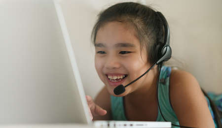 asian girl student wear headphone watch webinar listen online course communicate by conference video call. . Homeschooling and distance learning ,online ,internet protect from COVID-19 viruses.