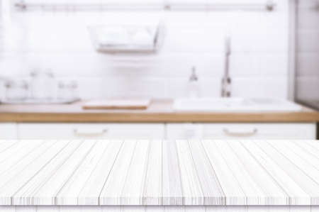 Wood table top on blurred kitchen background Stockfoto