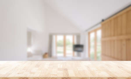 Wooden table top in front of blurred bedroom interior background.  for montage or display your products