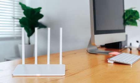 Modern router on light table in home office