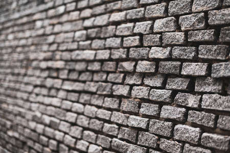 Shallow depth of field with Old vintage brick wall. Abstract architectural loft background for design.
