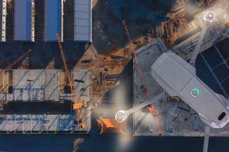 Drone over construction site. video surveillance or industrial inspection Фото со стока