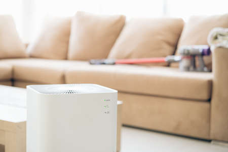 air purifier a living room,  air cleaner removing fine dust in house. protect PM 2.5 dust and air pollution concept