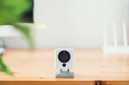 The CCTV security camera on Wood table in home, ip camera