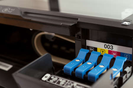 Replacement of CMYK set of ink cartridges in printer