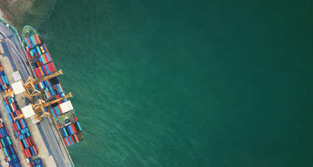 Aerial view from drone Logistics and transportation of Container Cargo ship and Cargo import export , Business logistics concept,