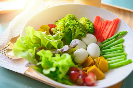 salad with vegetables and greens on wooden table Foto de archivo